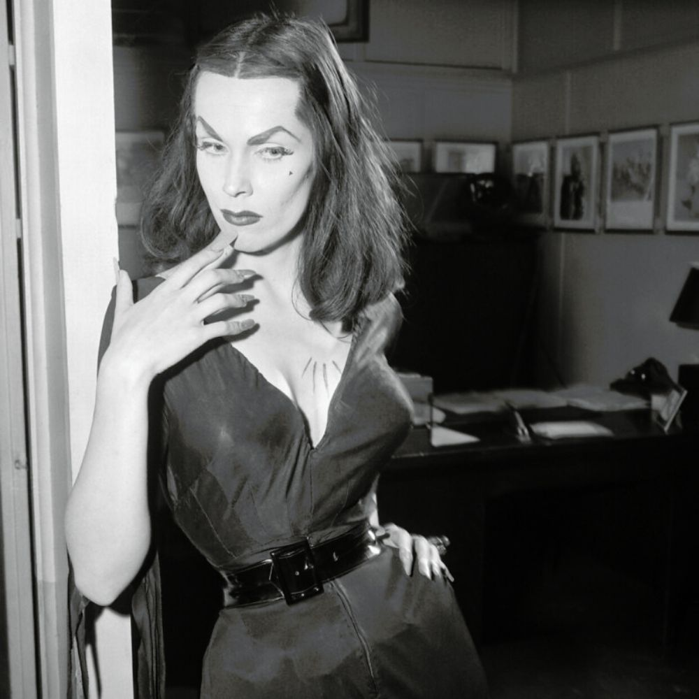 Actress Maila Nurmi as Vampira in a black corseted dress