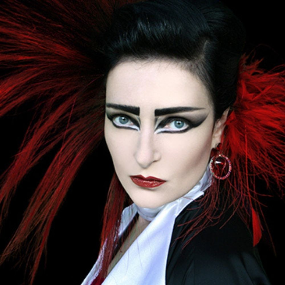 Siouxie Sioux with red hair tips and dark eye makeup