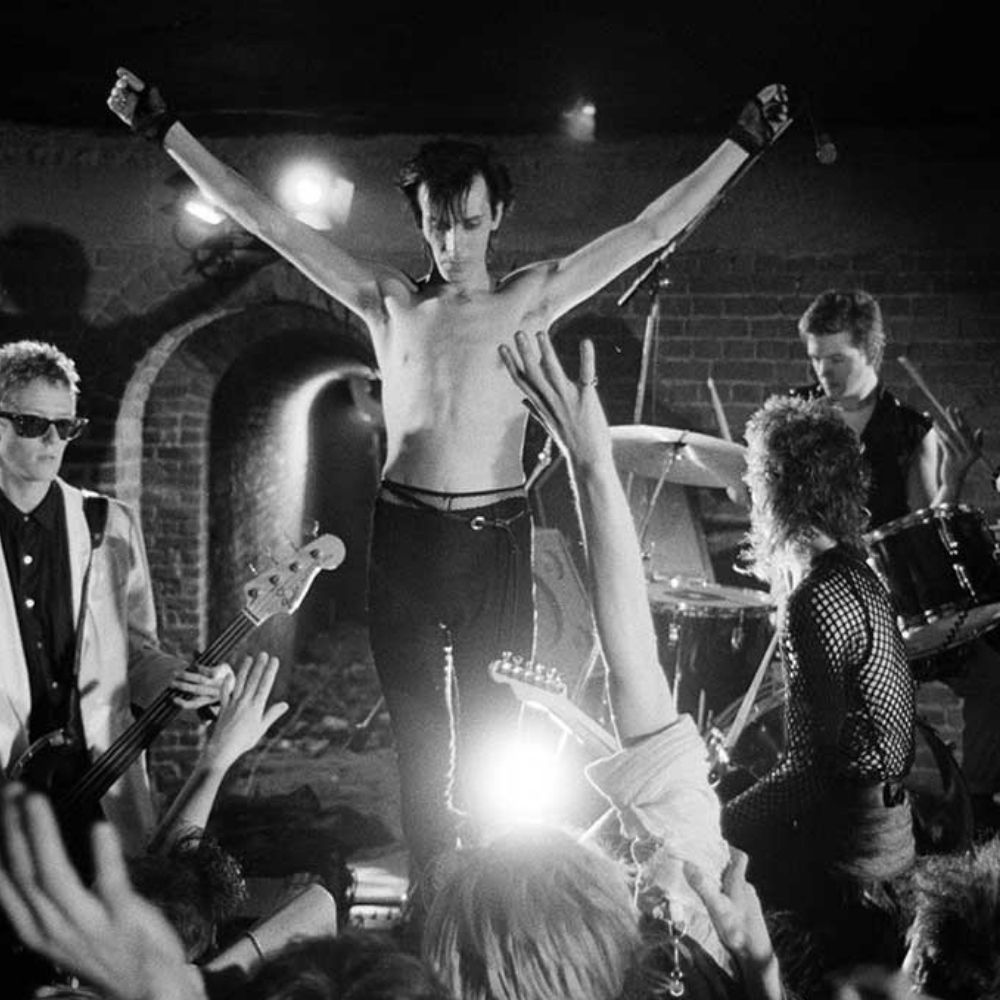 Peter Murphy shirtless and about to dive into a crowd